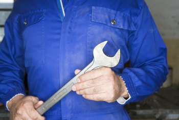 Mechanic holding spud wrench