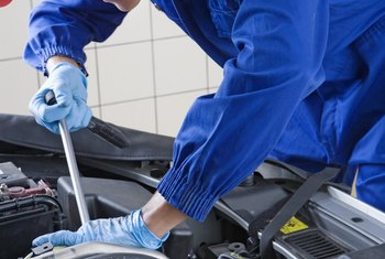 Auto mechanics spend most of their day inspecting and repairing vehicles