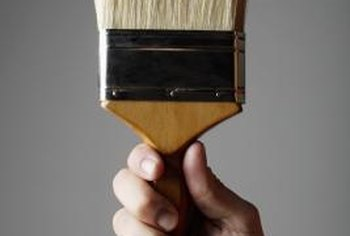 Apply whitewash with a regular paintbrush.