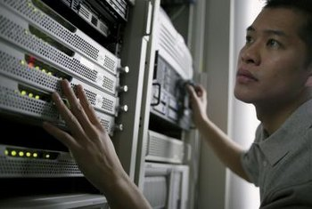 Some servers are housed in frames known as racks.