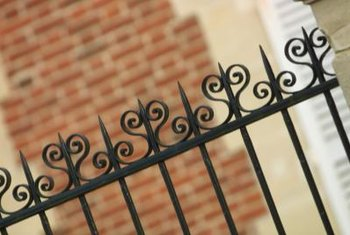 Wrought iron fences add a decorative element.