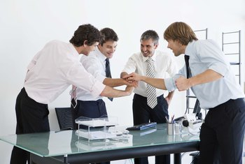 Building teams can result in a cooperative attitutude among workers.