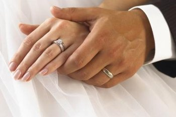 Those wedding bands will come off at work if company policy prohibits rings.