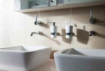 Side-by-side sinks share plumbing on the same wall.