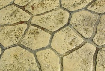 Paint realistic cobblestones, river rocks or flagstones on your concrete floor.