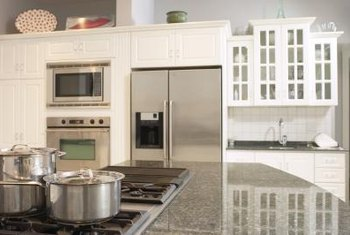 Several methods will remove adhesive from granite counters.