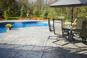 Decorate the pool deck to create an outdoor entertaining area.