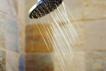 A clogged shower head is the likely culprit of low water pressure.