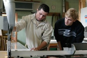 Master cabinetmakers begin as apprentices, learning from experienced professionals.