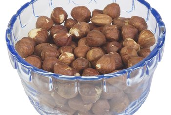 Hazelnuts, also known as filberts, grow on large shrubs or small trees.