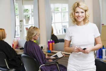 A beauty salon manager supervises cosmetologists.
