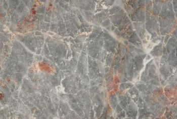 Paint and glaze create complex faux marble walls.