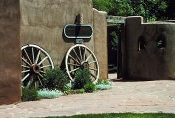 Stucco and wagon wheels create an instant Southwest effect.