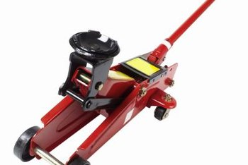 A hydraulic car jack requires less operator strength to remove lawn mower wheels.