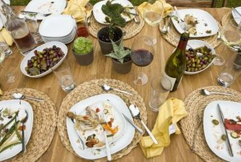 Use crisp white dishes, textured underplates and mini-potted plants as a centerpiece for cookout.