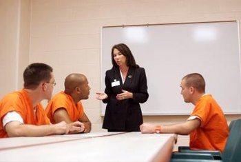 Community corrections case managers prepare inmates for release and counsel offenders.