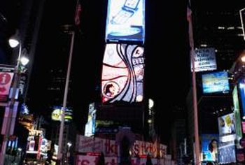 As seen in areas such as Times Square in New York, advertising is used as a powerful tool to persuade consumers to buy products.