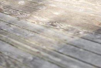Discoloration, warping and rot can affect old deck planks.