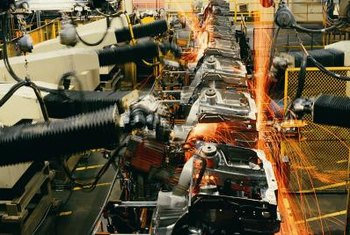 Some companies automate production processes to reduce labor expenses.