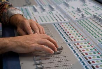 Sound engineers handle mixers in recording studios.