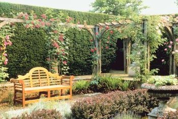 An alcove is an ideal spot to place a bench along your garden path.