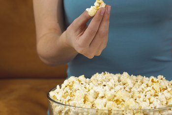 Popcorn is a whole-grain food and can keep you feeling full for hours.
