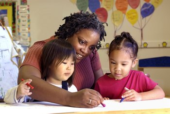 Child-care workers strive to keep children engaged.