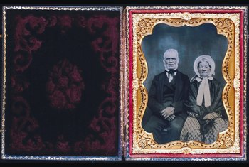 Safely removing glue from old photos preserves them for future family members.
