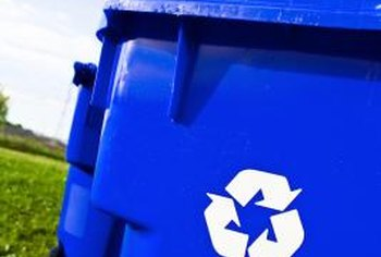 A big blue trash container is a standard fixture in towns that recycle household waste.