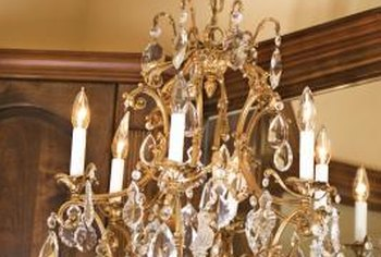 After relocating a chandelier, give it a good cleaning before putting it up in your new home.