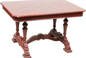 Repair mahogany tables using wood putty.