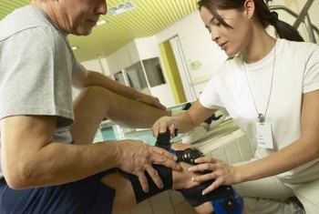 As a trainer, a physiotherapy assistant shows proper use of assistive devices.