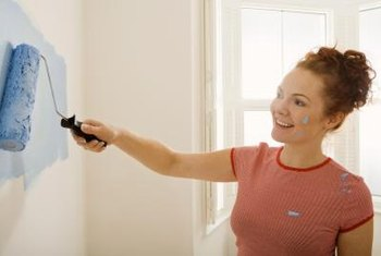A paint roller covers a large swath of wall quickly.
