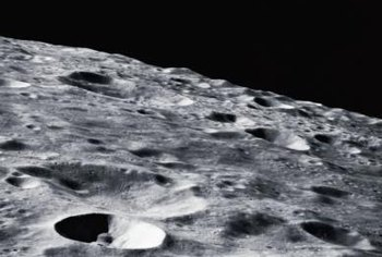 The moon's surface is littered with craters.
