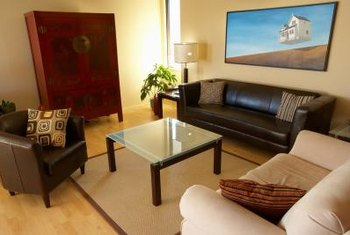 A leather couch can be damaged if it is placed up against the wall with a baseboard heater.
