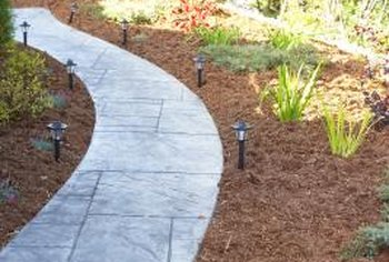 Bark and wood mulch can help reduce weed growth in landscapes.