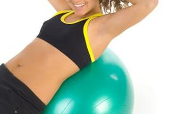 Use exercise balls in a variety of ways to engage your stomach muscles.
