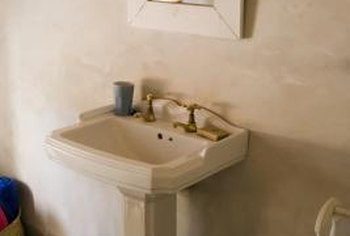 Pedestal sinks save space in small bathrooms.