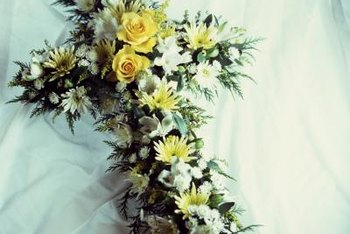 The placement of floral arrangements can be one of the duties of a funeral home assistant.