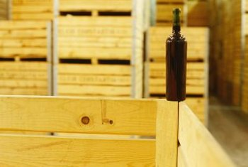 Wine crates and old shipping pallets become storage tables and building material.