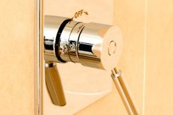 Improper seating of the shower's escutcheon can cause water leakage into the wall cavity.