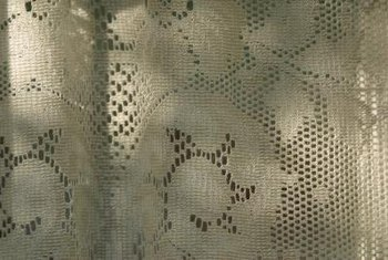 Lace fabric serves as a stencil for lacy paint designs.