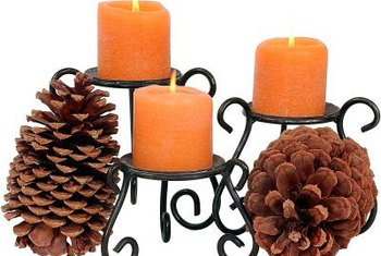 Simply rest pinecones against candles if you don't have to tools to make your own holders.