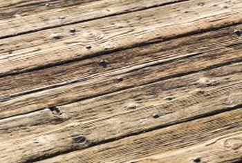 Restore weather-worn decks with a waterproofing stain.