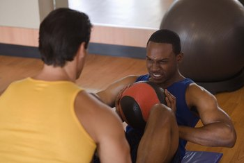 Medicine balls can work in place of a dumbbell.