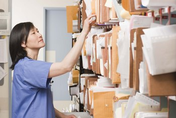 Hospital unit secretaries make paper files easily accessible.