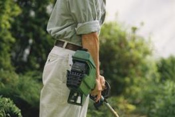A string trimmer is useful for cutting grass and weeds close to trees or hardscape areas.