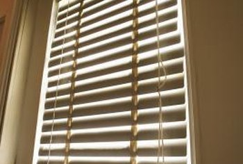 Typical Venetian blinds hang from a headrail, suspended by side brackets.