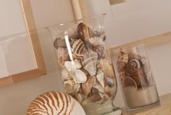 Decorate your kitchen by filling vases or jars with items from your favorite places, such as seashells from the beach.