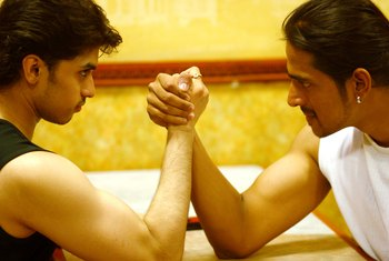 Bulging biceps look impressive, but strong wrists and forearms are more important for arm wrestling.